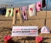 Protesto contra abuso sexual estende varal com roupas sujas de sangue