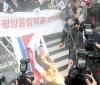 Norte-coreanos são recebidos com protestos na Coreia do Sul